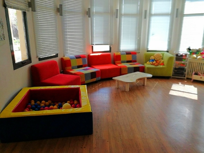 Waiting room with ball pit at Jordan River Village
