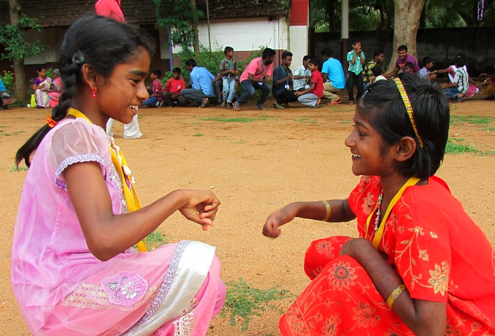 Campers playing rock, paper, scissors at Camp Rainbow in Batlagundu, India