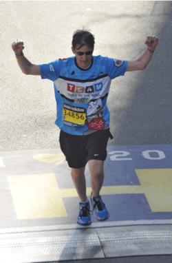 Matt DeCamara crossing finish line